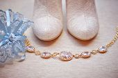 picture of garter  - white wedding bride shoes and garter on sofa - JPG