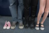 picture of child missing  - Parents and young girl shoes with a another child - JPG