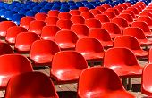 stock photo of bleachers  - Empty red and blue seats outside - JPG