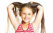 foto of throw up  - funny cheerful little girl throws her hair up - JPG