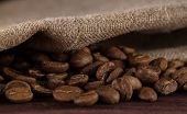 stock photo of brew  - roasted coffee beans on wooden table ready to brew delicious coffee  - JPG