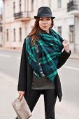 stock photo of cloak  - Portrait of fashionable woman in a cloak and a scarf - JPG