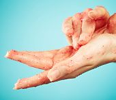 picture of scrubs  - Female hands in body scrub on blue background - JPG