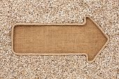 image of sackcloth  - Pointer made from rope with sunflower seeds lying on sackcloth with space for your text - JPG