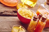 foto of scrubs  - Spa still life with sea salt oil and scrub for body on wooden background - JPG