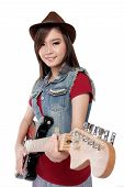 foto of fedora  - Pretty Asian guitarist girl in jeans jacket and fedora hat smiles at camera while holding her electric guitar on white background - JPG