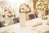 stock photo of wedding table decor  - Wedding table setting with flower in restaurant - JPG
