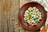 image of chickpea  - salad with chickpeas feta and parsley on a dark wood background - JPG