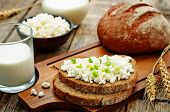 foto of whole-grain  - healthy Breakfast with whole grain rye bread cottage cheese and milk  - JPG