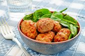 stock photo of meatball  - baked meatballs with pepper and spinach on a grey background - JPG