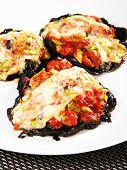 stock photo of portobello mushroom  - Stuffed portobello mushrooms with tomatoes and yellow cheese - JPG