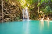 stock photo of jungle  - Water falls in spring season located in deep rain forest jungle - JPG