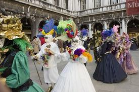 stock photo of venice carnival  - a couple prepare for carnivale parade in st marks squareveniceitalymargi gras european style - JPG