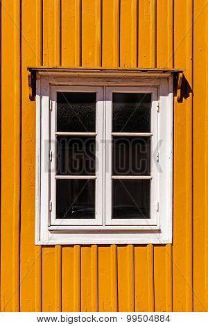 Window on a wooden facade