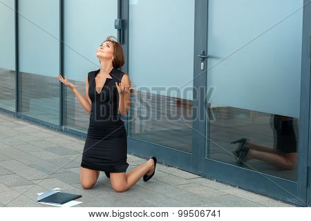Girl Kneels In Front Of The Office.