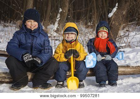 three boy play on snow