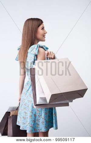 Attractive young girl is buying everything with passion