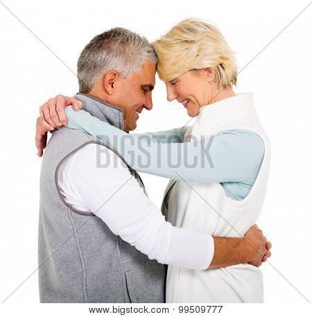 lovely senior couple hugging with eyes closed on white background