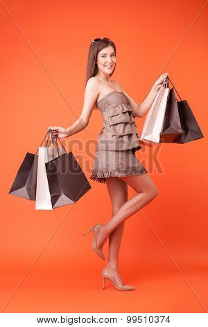 Attractive young woman is buying new clothing
