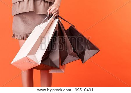 Cheerful young styled girl is going shopping