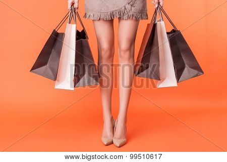 Cute young woman is going shopping with pleasure