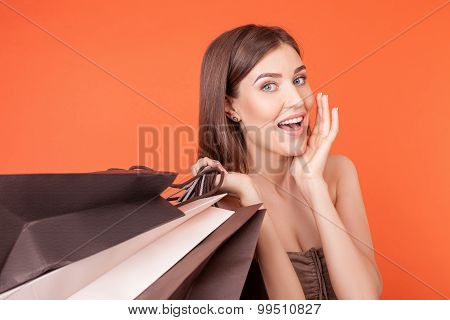 Beautiful young girl is crazy about shopping