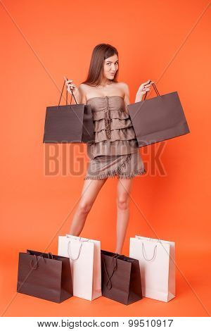 Cheerful young girl wants to buy everything