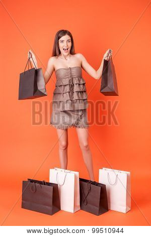 Attractive young woman is crazy about shopping