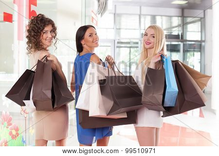 Attractive young girls are going shopping together