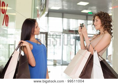 Pretty styled girls are going shopping in boutique