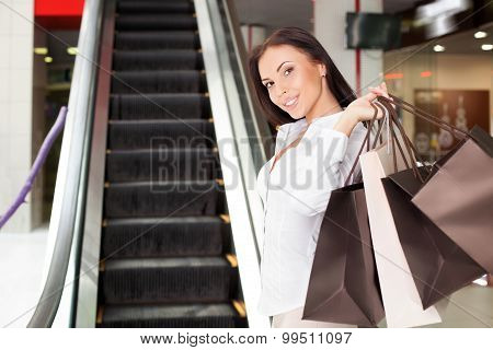 Attractive young styled girl is going shopping