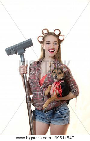 Sexi young blond lady in curlers holding doggy