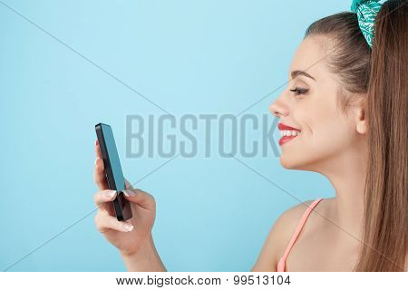 Beautiful young hipster woman is using modern technology