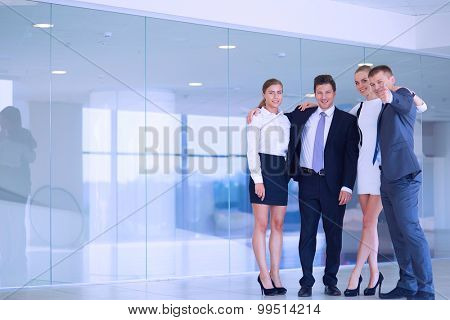 Smiling successful business team standing in office