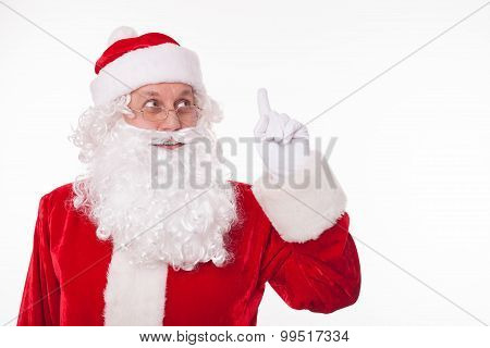 Cheerful Father Christmas is preparing for giving presents