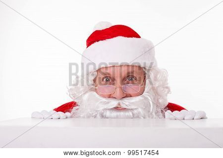 Cheerful Santa Claus is waiting for you