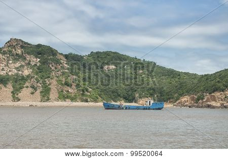 Fishing Boat Near Island