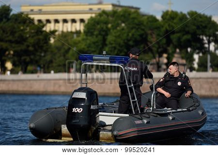 ST. PETERSBURG, RUSSIA - AUGUST 20, 2015: Police boat on the river Neva during 1st day of St. Petersburg stage of Extreme Sailing Series. Red Bull Sailing Team of Austria won the day with 58 points