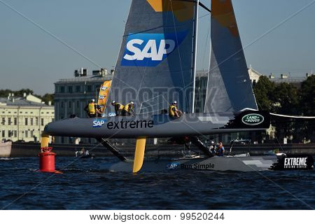 ST. PETERSBURG, RUSSIA - AUGUST 21, 2015: Catamaran of SAP Extreme Sailing Team of Denmark during the 2nd day of St. Petersburg stage of Extreme Sailing Series. Red Bull Team leading after the 1st day