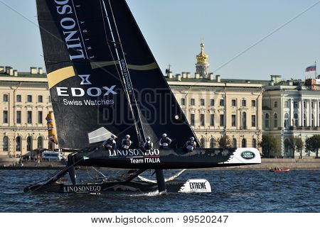 ST. PETERSBURG, RUSSIA - AUGUST 21, 2015: Catamaran of Lino Sonego Team Italia of Italy during the 2nd day of St. Petersburg stage of Extreme Sailing Series. Red Bull Team leading after the 1st day