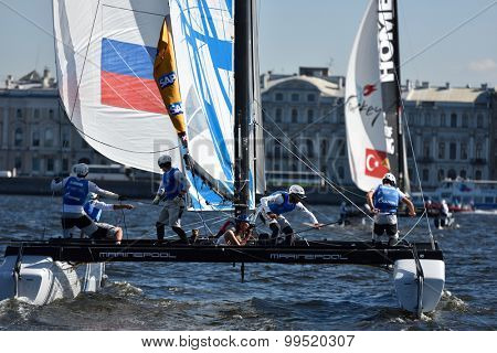 ST. PETERSBURG, RUSSIA - AUGUST 21, 2015: Catamaran of Gazprom Team Russia during 2nd day of St. Petersburg stage of Extreme Sailing Series. Red Bull Sailing Team of Austria leading after the 1st day