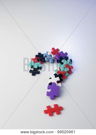 colorful jigsaw puzzle form a question mark