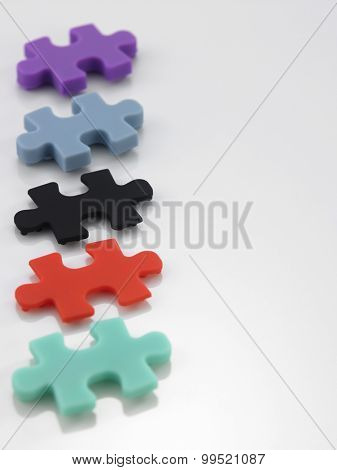 colorful jigsaw puzzle on the white background