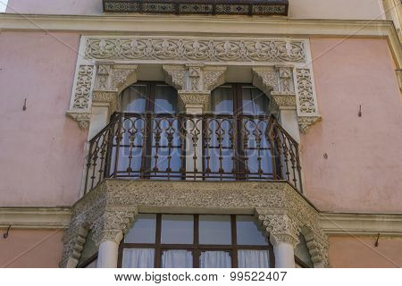 Moorish-style balconies, streets of the city Toledo, medieval architecture and Castilian