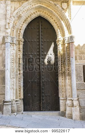 Ancient door, majestic facade of the cathedral of Toledo in Spain, beautiful church