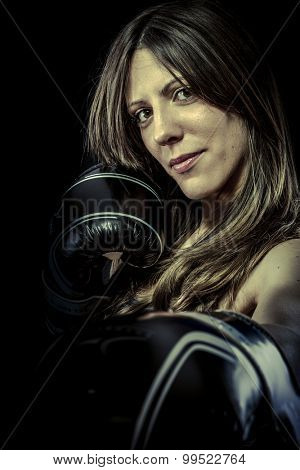 Power, strong woman athlete with boxing gloves