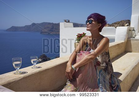 Woman Enjoy Sunshine At Santorini