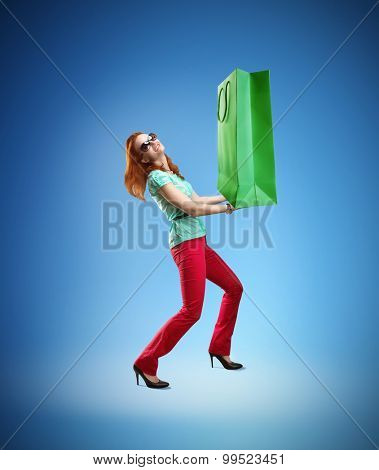 Woman holding huge shopping bag