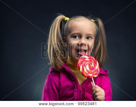 Little girl eating lollipop