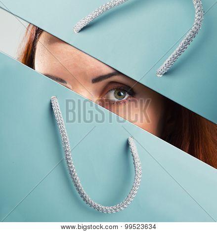 Woman looks through shopping bag
